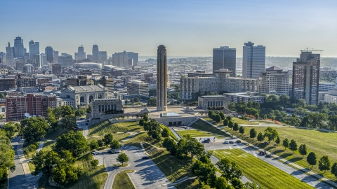 DXP001_043_0005 - Aerial stock photo of The WWI memorial in Kansas City, Missouri, with a view of the downtown skyline