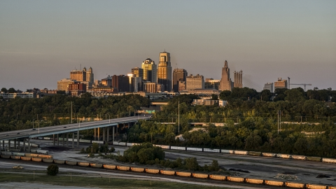 DXP001_046_0002 - Aerial stock photo of The city skyline at sunset seen from train tracks in Downtown Kansas City, Missouri