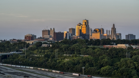 DXP001_046_0004 - Aerial stock photo of The city's skyline at sunset in Downtown Kansas City, Missouri