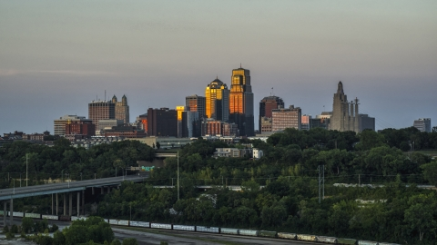 DXP001_046_0005 - Aerial stock photo of The tall skyscrapers of the city skyline at sunset in Downtown Kansas City, Missouri