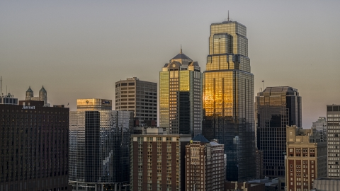 DXP001_051_0002 - Aerial stock photo of Light reflecting off of skyscrapers at sunset in Downtown Kansas City, Missouri
