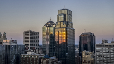 DXP001_051_0008 - Aerial stock photo of A view of city skyscrapers at sunset in Downtown Kansas City, Missouri