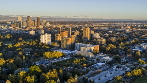 DXP001_052_0002 - Aerial stock photo of A group of apartment buildings at sunrise in Denver, Colorado
