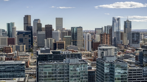 DXP001_055_0006 - Aerial stock photo of The city's skyline seen from office building rooftops in Downtown Denver, Colorado