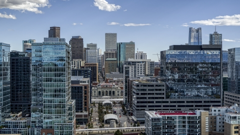 DXP001_055_0007 - Aerial stock photo of The city's skyline behind office buildings in Downtown Denver, Colorado