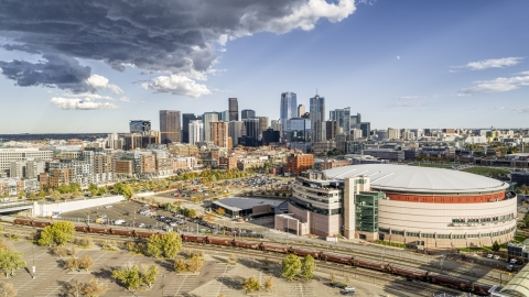 DXP001_056_0004 - Aerial stock photo of A view of arena, and the city skyline in the distance, Downtown Denver, Colorado