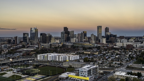 DXP001_057_0001 - Aerial stock photo of Wide view of the city's skyline at sunset, Downtown Denver, Colorado