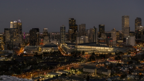 DXP001_057_0007 - Aerial stock photo of The city's skyline behind the convention center at twilight, Downtown Denver, Colorado