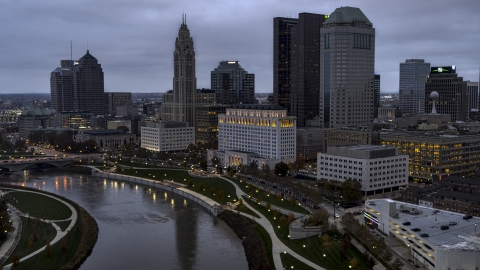 DXP001_087_0008 - Aerial stock photo of The Scioto River and city skyline at twilight, Downtown Columbus, Ohio