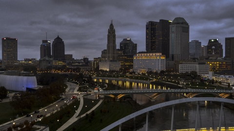 DXP001_087_0011 - Aerial stock photo of The city skyline at twilight seen from the river and bridges in Downtown Columbus, Ohio