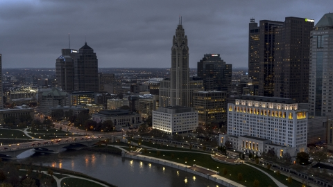 DXP001_087_0012 - Aerial stock photo of A view of LeVeque Tower across the river at twilight, Downtown Columbus, Ohio