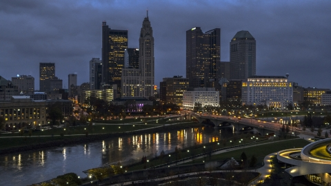 DXP001_088_0001 - Aerial stock photo of The city skyline across the river at twilight, Downtown Columbus, Ohio