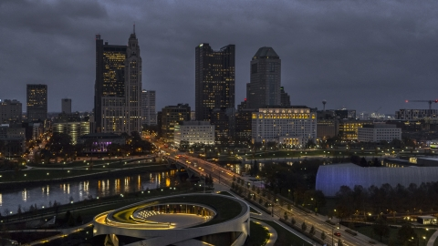 DXP001_088_0005 - Aerial stock photo of The city's downtown skyline across the bridge and river at twilight, Downtown Columbus, Ohio
