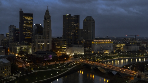 DXP001_088_0006 - Aerial stock photo of The city's skyline beside a bridge and river at twilight, Downtown Columbus, Ohio