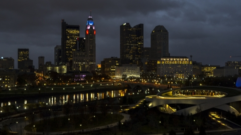 DXP001_088_0011 - Aerial stock photo of The city skyline's tall skyscrapers across the river at twilight, Downtown Columbus, Ohio