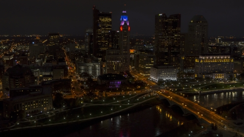 DXP001_088_0013 - Aerial stock photo of The city skyline, and bridge spanning the river at night, Downtown Columbus, Ohio