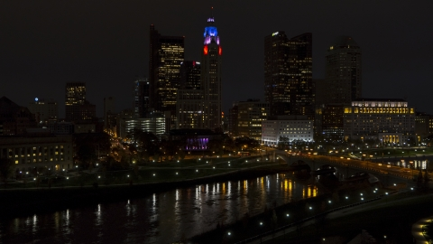 DXP001_088_0014 - Aerial stock photo of LeVeque Tower and bridge spanning the river at night, Downtown Columbus, Ohio