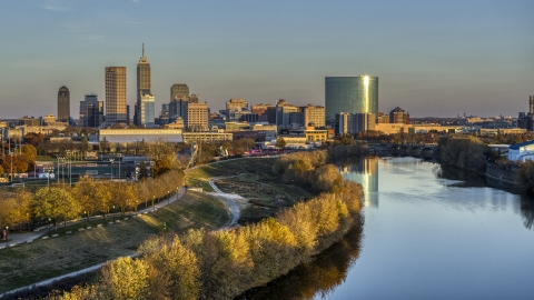DXP001_092_0007 - Aerial stock photo of The city's skyline at sunset seen from White River, Downtown Indianapolis, Indiana