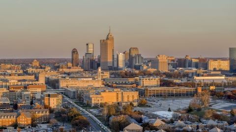 DXP001_092_0011 - Aerial stock photo of A wide view of the city's downtown skyline at sunset, Downtown Indianapolis, Indiana