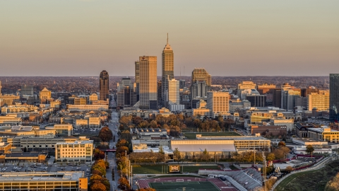DXP001_092_0012 - Aerial stock photo of Wide view of the city's downtown skyline at sunset, Downtown Indianapolis, Indiana
