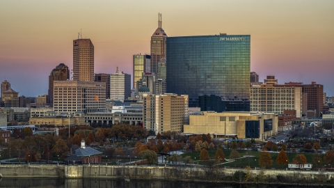 DXP001_092_0013 - Aerial stock photo of A hotel and the city's skyline at sunset, Downtown Indianapolis, Indiana