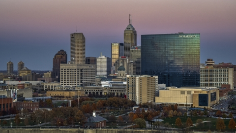DXP001_092_0020 - Aerial stock photo of The city's tall skyline and a hotel at sunset in Downtown Indianapolis, Indiana