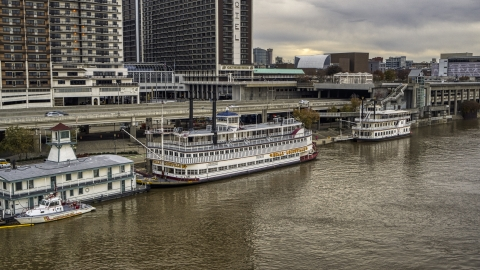 DXP001_095_0016 - Aerial stock photo of Historic riverboat docked by Downtown Louisville, Kentucky