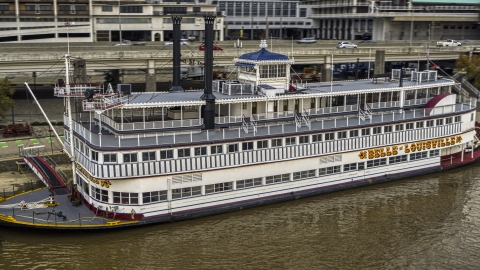DXP001_095_0017 - Aerial stock photo of Close-up view of the historic riverboat docked by Downtown Louisville, Kentucky