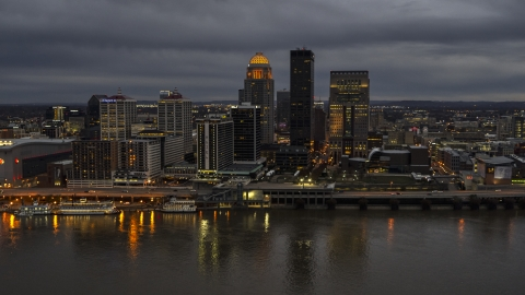DXP001_096_0012 - Aerial stock photo of Skyscrapers and city buildings at night in Downtown Louisville, Kentucky