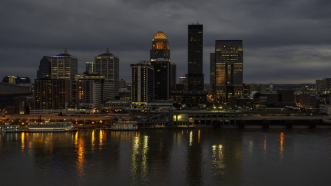 DXP001_096_0013 - Aerial stock photo of Tall skyscrapers lit up for the night in Downtown Louisville, Kentucky