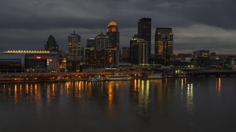 DXP001_096_0014 - Aerial stock photo of A view of the skyline lit up at twilight, seen from Ohio River, Downtown Louisville, Kentucky