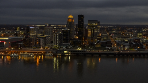 DXP001_096_0015 - Aerial stock photo of The city's skyline at twilight, seen from Ohio River, Downtown Louisville, Kentucky