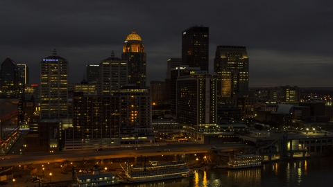 DXP001_096_0016 - Aerial stock photo of A view of hotel and the city skyline at twilight beside the river, Downtown Louisville, Kentucky