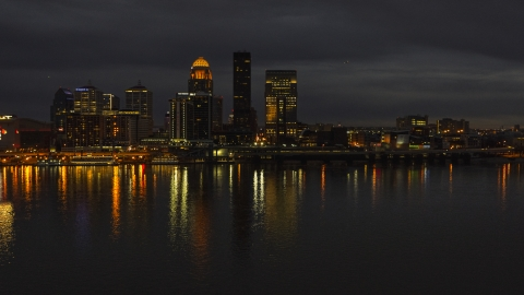DXP001_096_0017 - Aerial stock photo of The city skyline at twilight across the river, Downtown Louisville, Kentucky