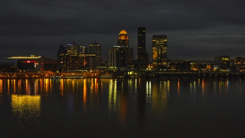 DXP001_096_0018 - Aerial stock photo of A view across the Ohio River toward the city skyline at twilight, Downtown Louisville, Kentucky