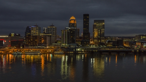 DXP001_096_0019 - Aerial stock photo of The Ohio River with a view of the city skyline at twilight, Downtown Louisville, Kentucky