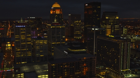 DXP001_096_0022 - Aerial stock photo of Tall buildings in the city's skyline lit up at twilight, Downtown Louisville, Kentucky