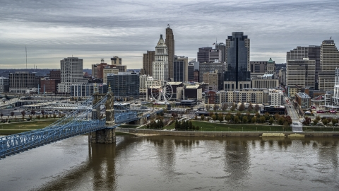 DXP001_097_0003 - Aerial stock photo of The bridge and river with view of city skyline, Downtown Cincinnati, Ohio
