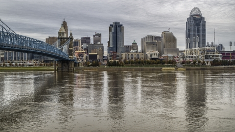 DXP001_097_0008 - Aerial stock photo of A view across the river by bridge focusing on city skyline, Downtown Cincinnati, Ohio
