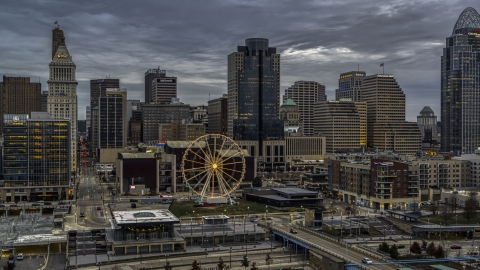 DXP001_097_0010 - Aerial stock photo of The Ferris wheel and the city skyline at sunset, Downtown Cincinnati, Ohio