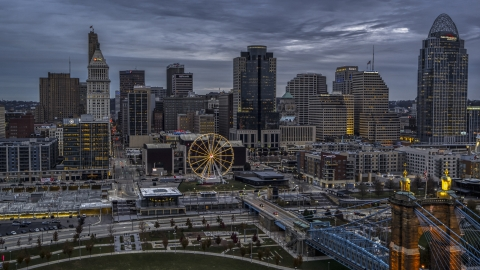 DXP001_097_0013 - Aerial stock photo of The city skyline and the Ferris wheel at sunset, Downtown Cincinnati, Ohio