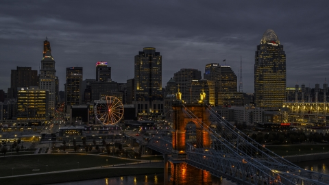DXP001_098_0005 - Aerial stock photo of Roebling Bridge and city skyline lit up at twilight, Downtown Cincinnati, Ohio