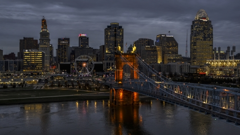 DXP001_098_0006 - Aerial stock photo of A view of the bridge and city skyline at twilight from the river, Downtown Cincinnati, Ohio