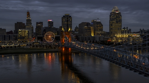 DXP001_098_0007 - Aerial stock photo of The lights of city skyline and bridge at twilight seen from the river, Downtown Cincinnati, Ohio