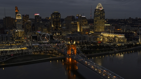 DXP001_098_0013 - Aerial stock photo of The city skyline at twilight, seen from river near bridge, Downtown Cincinnati, Ohio