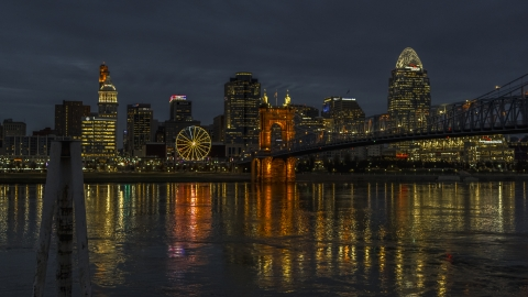 DXP001_098_0016 - Aerial stock photo of The city's downtown skyline across the Ohio River at twilight, Downtown Cincinnati, Ohio