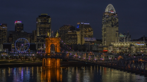 DXP001_098_0017 - Aerial stock photo of The Roebling Bridge at night and the city skyline, Downtown Cincinnati, Ohio