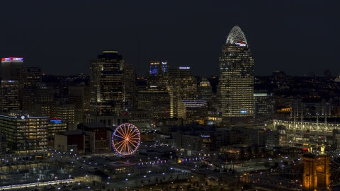DXP001_098_0020 - Aerial stock photo of A view of the city skyline and Ferris wheel at night, Downtown Cincinnati, Ohio