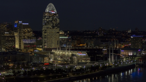 DXP001_098_0021 - Aerial stock photo of Tall skyscraper and the baseball stadium at night, Downtown Cincinnati, Ohio