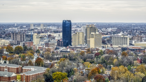 DXP001_099_0003 - Aerial stock photo of A view of the city's skyline, seen from tree-lined neighborhoods, Downtown Lexington, Kentucky